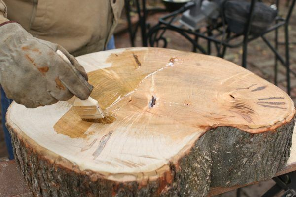 Apply wood stabilizer to table surface.