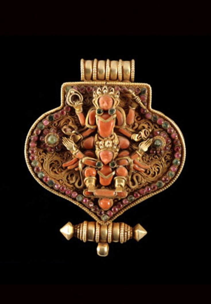 Nepal   Gau; amulet container or prayer box in gold plated silver, coral, turquoise and semi precious stones   19th century