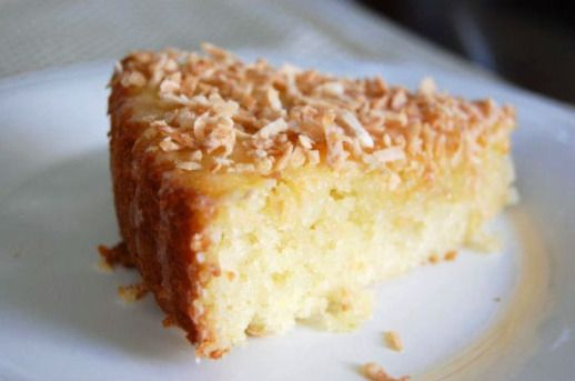 Key Lime Coconut Cake  1 cup sweetened flaked coconut 1 stick unsalted butter, softened 1 1/4 cups granulated sugar 1 tablespoon grated Key lime zest 2 large eggs 1 3/4 cups self-rising flour 3/4 cup 2 percent milk 1/4 cup fresh Key lime juice, divided 1 cup confectioners sugar 1 tablespoon rum (optional)