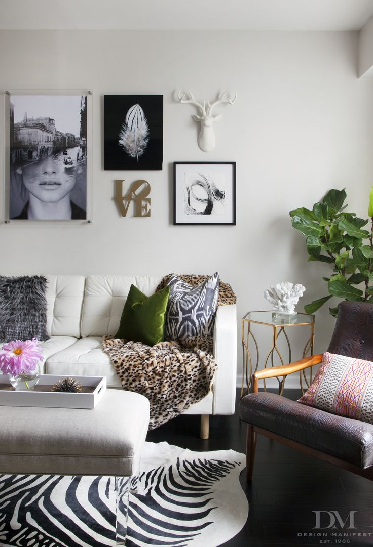 White leather living room furniture - White Leather Sofa With Zebra Art Wall Fiddle Leaf Fig Lucite Ottoman