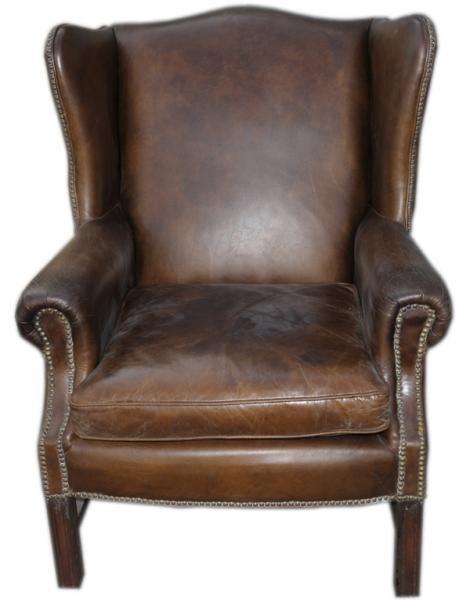 """Eksklusiv Wing ørelappstol med nagler. Stolen har svært høy kvailtet og en lekker finish.Stolen er produsert i en antikk """"vintage leather"""" og er meget behagelig å sitte"""