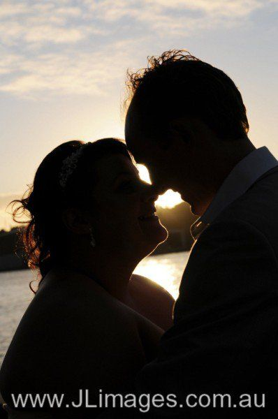 A captured silhouette against a beautiful sunset. Check out this couples joyous moment on their wedding day. #jlimages #weddingphotography #wedding #photography #bride #groom #silhouette #sunset