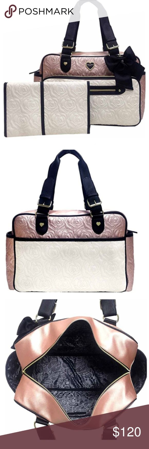 "Rose Gold Weekender Diaper Bag I love this bag! Classy, Rose Gold, Black and Cream Betsey Johnson Diaper Bag with Matching Changing Pad. New with tags. Bag measures 15""H x 10""W x 7""D x 9"" with Dual Handles. Bag also has stroller straps and a cute Black Bow! Exterior features 2 exterior zippered front pockets with Super Cute Diaper Pin pull, insulated bottle side slip Betsey Johnson Bags Baby Bags"