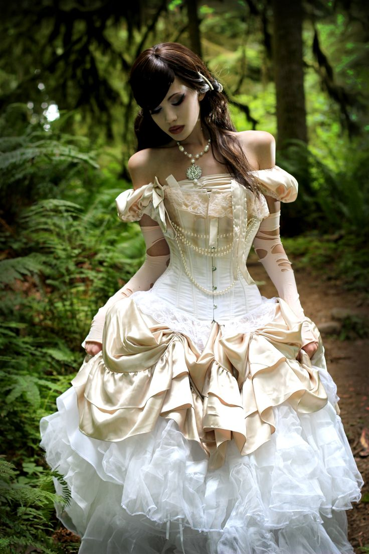"Corseted steampunk gown in ivory and white. #Steampunk ""... a compilation of different clothes, styled by the very lovely Kato. There is a dress, corsets, and several different petticoats and leggings somewhere in the outfit."""