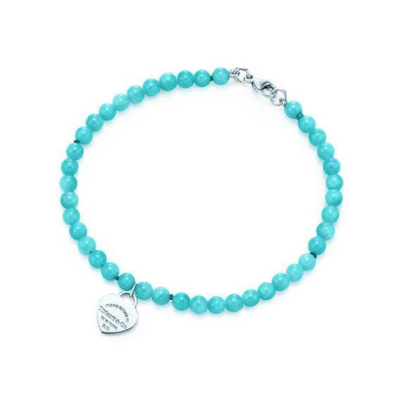 Return to Tiffany® mini heart tag in silver on an amazonite bead bracelet.