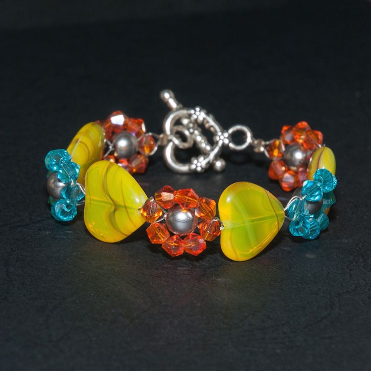 Made from 4mm glass bicone and 15mm glass heart with heart clamp.