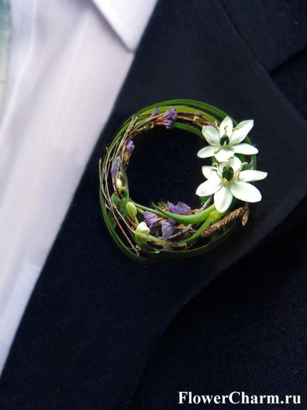 Pretty contemporary boutonniere with white ornithogalum and decorative grasses by www.flowercharm.r...