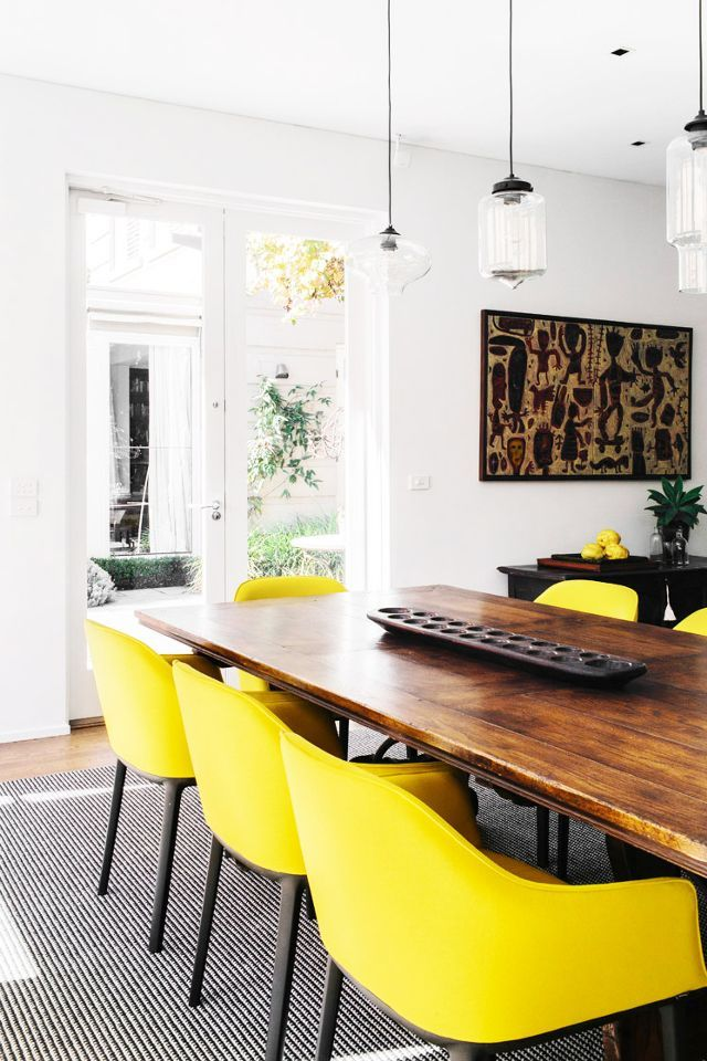 Black and yellow dining room