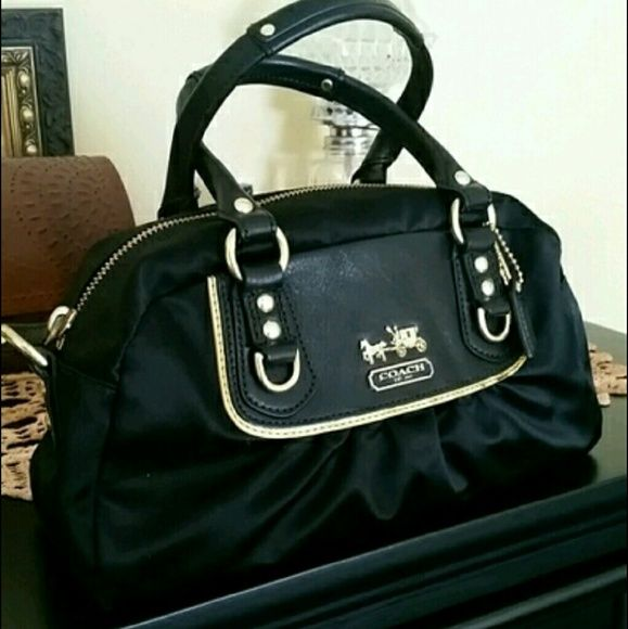 "♡♡HP 2/6♢♡ Women's mini Coach handbag. Women's mini satchel style Coach handbag.  Black satin and leather.  Given to my daughter by an ex. Never used.  Includes dust bag also. 12""W x  6""H x  4""D. There is a shoulder strap for this purse, but it is not the original,  had to buy a replacement one. As the original one was lost during my daughter moving twice in the last year. Coach Bags Mini Bags"