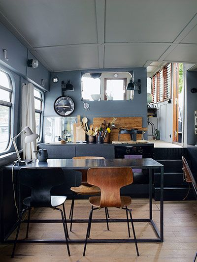 Homes: Paris Boat: Kitchen and dining area on houseboat >> not really FOR the home, more just a general home...