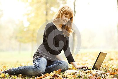 The beautiful girl in autumn park