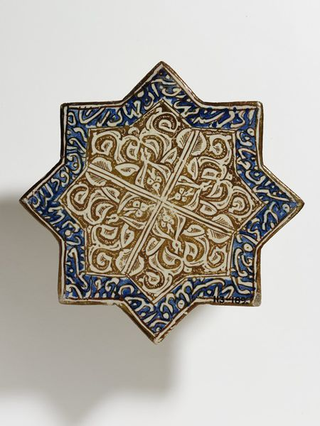 Tile      Place of origin:      Kashan, Iran (made)     Date:      early 14th century (made)     Artist/Maker:      unknown (production)     Materials and Techniques:      Fritware with metallic lustre over the glaze     Museum number:      113-1895