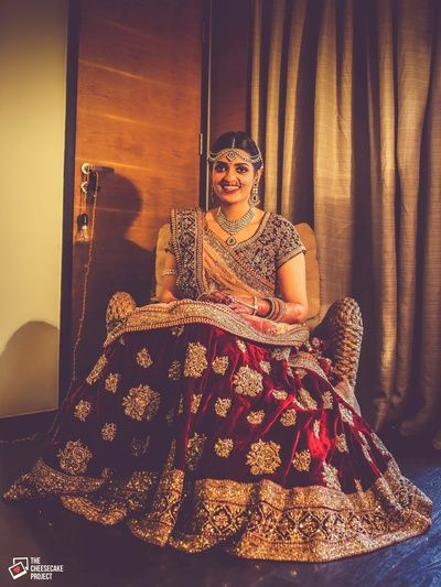 Bridal Lehenga - Marsala and Gold Bridal Lehenga with Beige Net Dupatta | WedMeGood | Marsala Velvet Lehenga with Golden Scattered Booties, Marsala Choli  #wedmegood #indianbride #indianwedding #velvet #marsala #bridal #lehenga