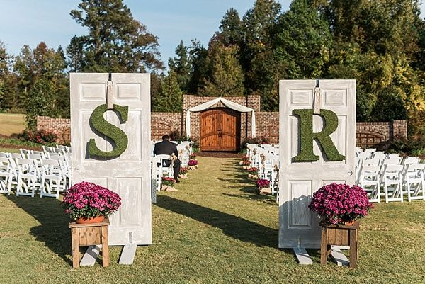 Outdoor Wedding Ideas - Vintage door ceremony entrance with moss covered monograms | Photo by A.J. Dunlap Photography | Southern Fall Wedding at The Oaks at Salem on heartlovealways.com