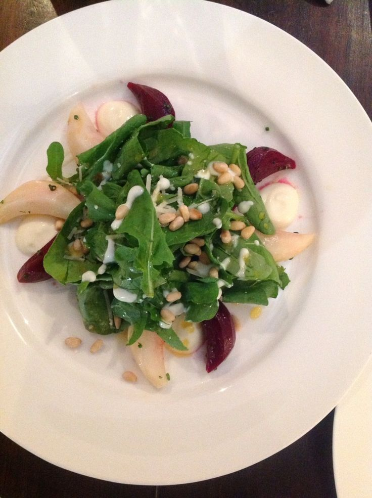 Beetroot and Celeriac Salad accompanied by Rocket and Pine Nuts and drizzled with a Truffle, Orange and Yoghurt Dressing