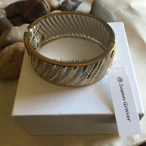 Susan graver gold and silver tone bracelet Beautiful new with tags Susan graver bracelet original box and packing. Hard metal bangle made to fit a small to 7 inch wrist. Purchased in qvc never wore. Beautiful perfect for fall and winter when jewelry gets bigger. 1 inch wide.  NO TRADES. NO LOWBALL OFFERS. Susan Graver Jewelry Bracelets