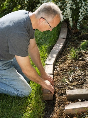20 Ways to Add Curb Appeal - line front corner bed with bricks/stone/etc.