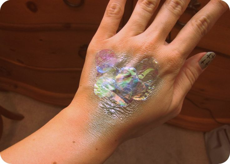 My mermaid halloween costume - liquid latex to create texture & iridescent eyeshadow to create colors. Glue sequins on for sparkle! Do patches on temple, arms, & hands