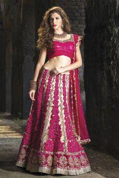 Net ghagra embellished with resham, badla and zardosi work along with contrast net dupatta.