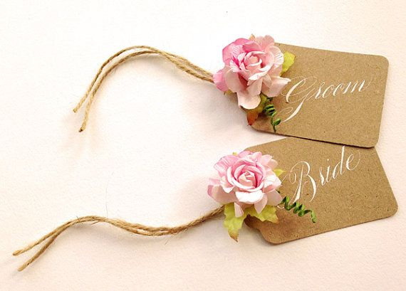 For Nepali buffet: red manila tags, need to buy paper flowers from Spotlight, and ribbons  Rustic manilla rose wedding place names x 10 by Calligraphystore