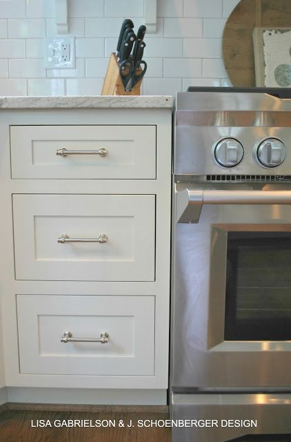 IDEA FOR KITCHEN hardware Lagarno from Restoration Hardware installed horizontally and centered. LOVE. Paint is Mascarpone by Benjamin Moore. LOVE.  White subway tile with white grout instead of 'oyster'.