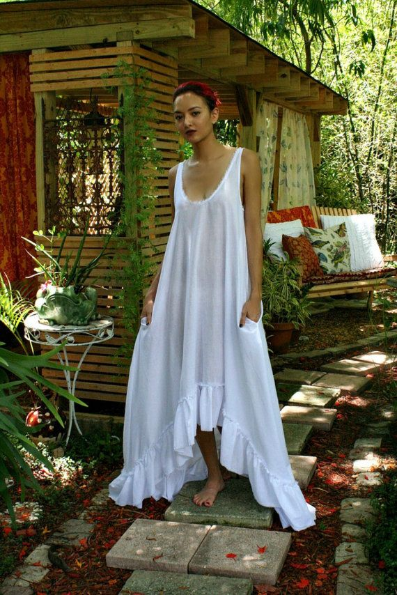 100% ruffled cotton nightgown Cottage Chic, Garden tea, Paris apartment? This is the perfect gown for any background. Ultra light, feather soft cotton lawn, a romantic full sweep with a wide ruffled hem. Front of gown dances mid shin and falls to full length in back, not your ordinary cotton gown. Comfort should also be elegant. Low scoop neckline is edged with a delicate unfinished cotton border. Hem is also unfinished in cottage chic fashion which will fray to a sweet fringe finish. Two…