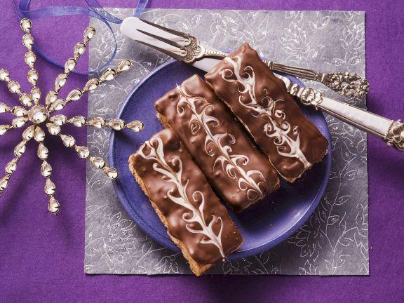 Probieren Sie den leckeren Honigkuchen mit Schokoladenglasur von EAT SMARTER oder eines unserer anderen gesunden Rezepte!
