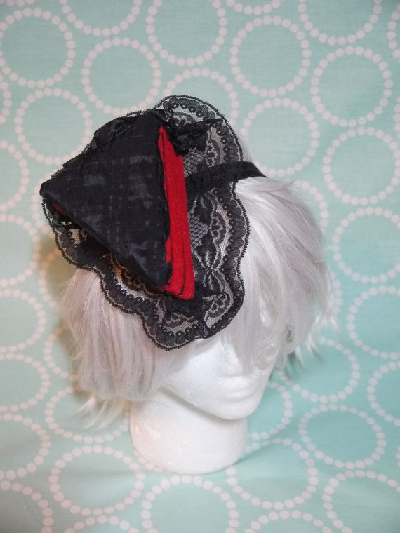 Red Velet Cake with Black Frosting Lolita Hat Fascinator worn with a Elastic Headband Hand made items with one of a kind design. Currently sized for adults. please let the artist know if this will be worn by children.