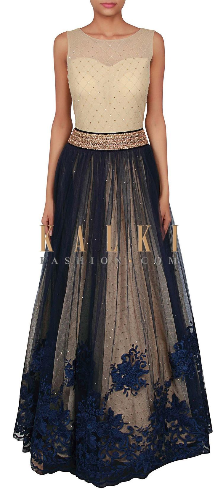 Buy Online from the link below. We ship worldwide (Free Shipping over US$100) http://www.kalkifashion.com/cream-and-navy-blue-gown-adorn-in-resham-and-kundan-embroidery-only-on-kalki.html