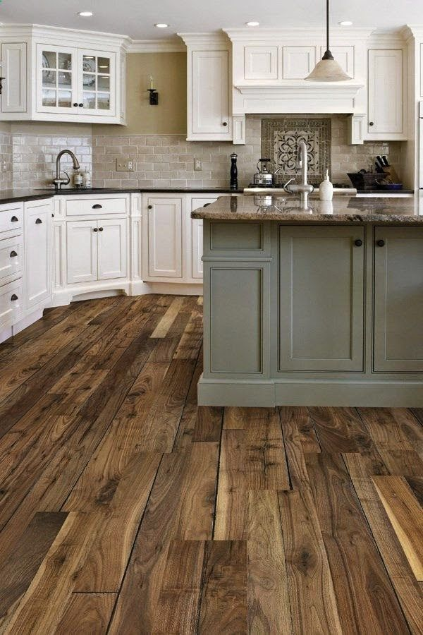 Farmhouse Kitchen.  Love the white cabinets and the floor.  Love that the island is a different color