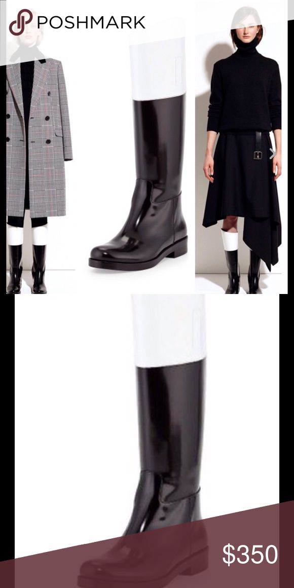 Michael Kors Runway Black and White Boots This is the high end MK Runway collection. Retailed for 995. Genuine patent leather. This boot is one of a kind. In a few months you'll be glad you bought them. They have been tried on but never worn. No box. Michael Kors Shoes