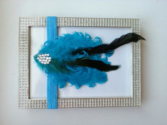 Naptime blue feather headband.  https://www.etsy.com/listing/192170482/blue-nagorie-goose-feather-pad-headband