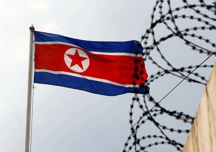 North Korea denies chemical weapons link with Syria: state media   - March 2, 2018.  The North Korea flag flutters next to concertina wire at the North Korean embassy in Kuala Lumpur