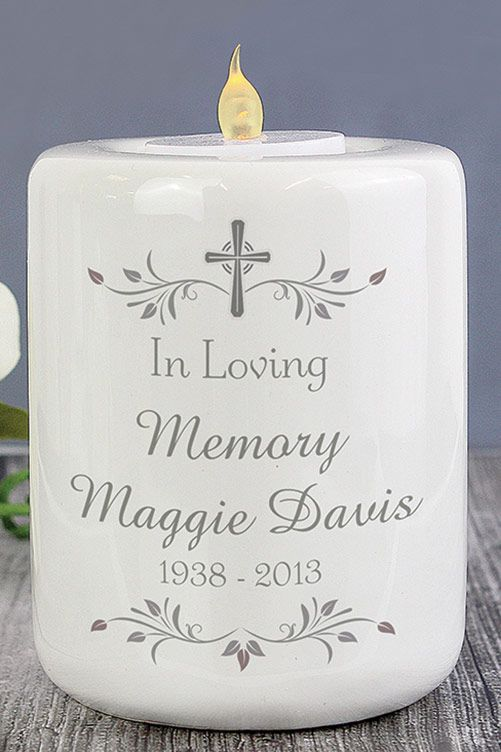 A beautiful way to remember a loved one. Holds standard tea light (not included). Ceramic. H10 x W8 x D8cm.