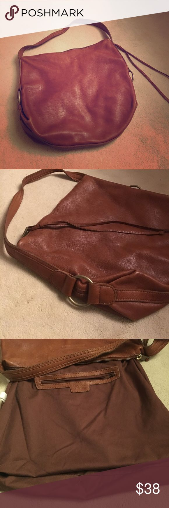 """BANANA REPUBLIC Leather Handbag Soft brown leather hobo bag that's slightly worn in all the right places. Rustic feeling but not cheap, the real leather feels rich. Leather has a few marks , the most noticeable one is pictured.  Bottom is nice and inside is totally clean.          15"""" wide and 12"""" high Banana Republic Bags Hobos"""