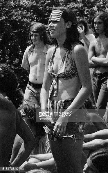 8/20/1972Miami Beach FL This girl is properly attired for Miami Beach both its weather and its politics The upsidedown American flag on her forehead...