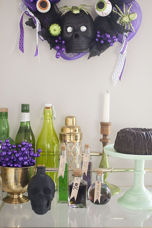 Halloween party ideas a purple green black dining room