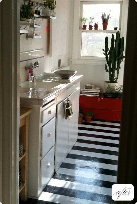 make seriously budget-friendly linoleum tiles ($0.59 per sq. ft) look majorly luxe by cutting them in half and laying them in a striped pattern.