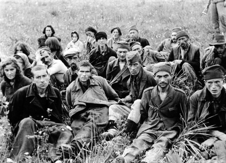 """A group of Yugoslavian partisan`s are photographed - after being captured by theGerman mountain infantry div 7`th SS Volunteer Mountain Division """" Prinz Eugen """". Near Omiš - Split-Dalmatia County . Croatia 14 June 1943"""