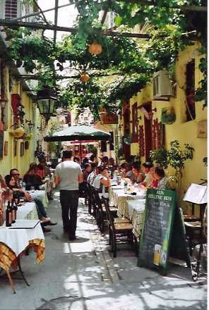 Goal in life: eat at a cafe in Greece. love the overhead plants and court yard/ street feel