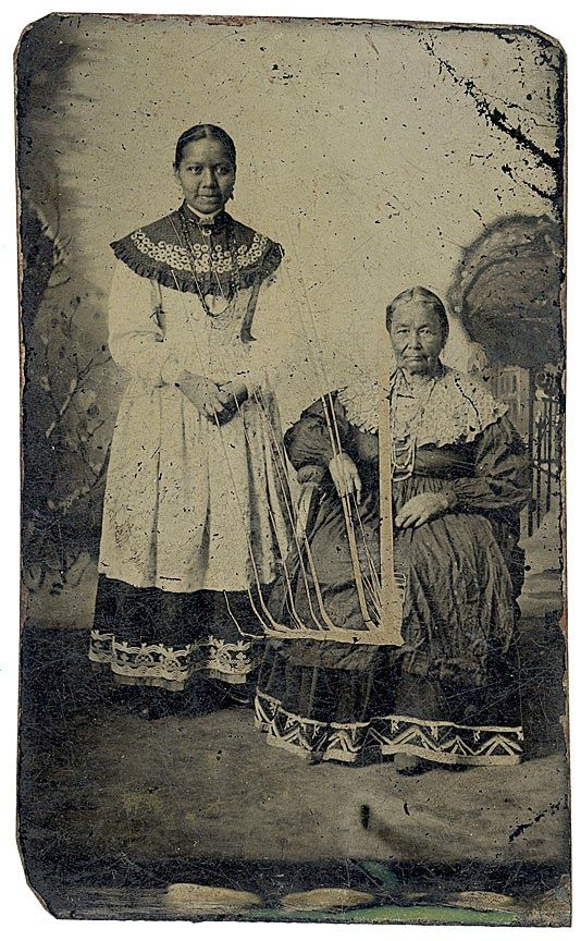 Circa 1860 tintype of two Seneca women in their traditional dress. Their collars are decorated with silver brooches. Private collection.
