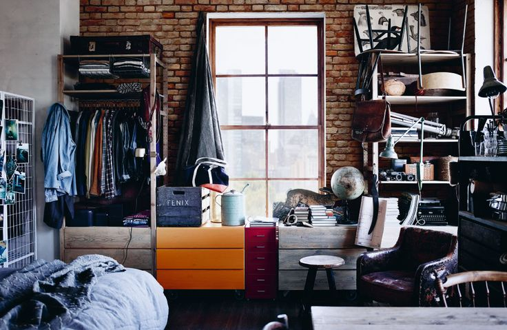 Combine open and closed storage in a mixture of materials like natural wood, brick walls and open shelves with books and clothes to get an urban look.
