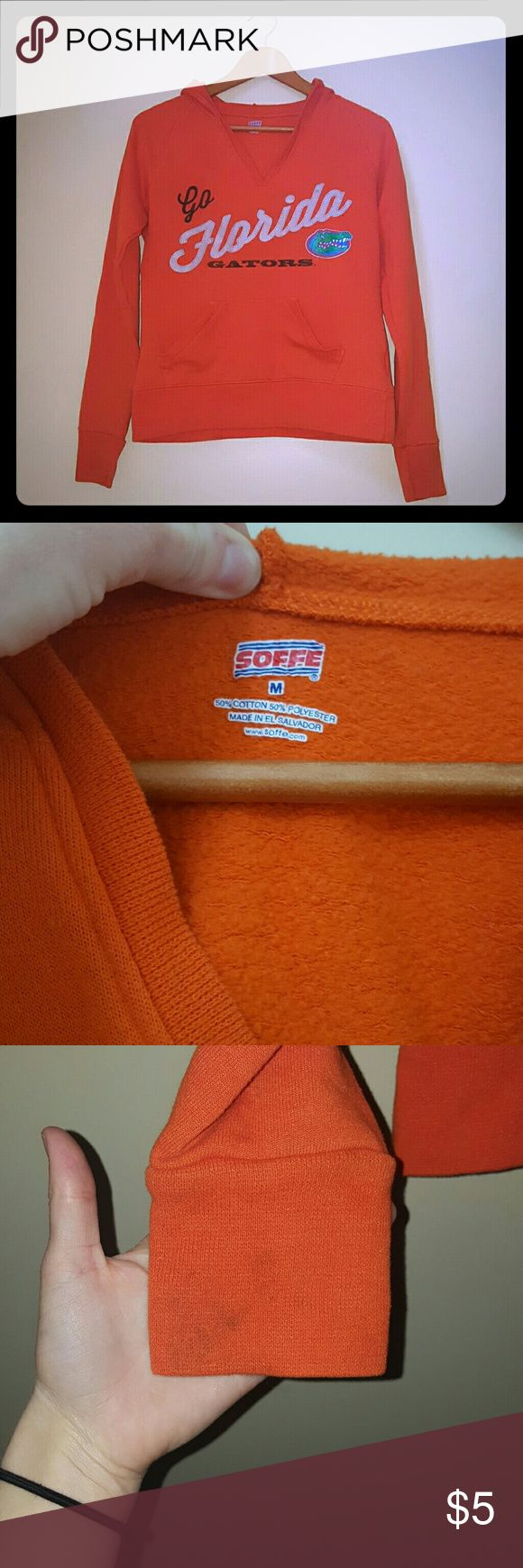 Soffe Gators hoodie This is a throw on and go kinda hoodie. Really comfy. Florida gators logo. Their is a minor stain on the bottom arm as shown in pictures. Otherwise in good condition. Soffe Jackets & Coats