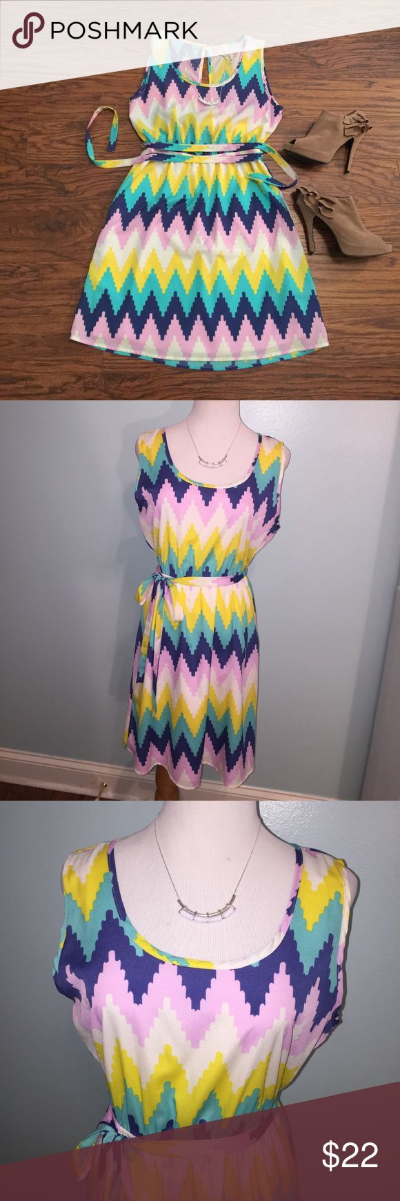 """Open back chevron print dress Size medium. Bust is approximately 18.5"""". Skirt is lined. Beautiful open back design. Comes with fabric belt. 100% polyester. Yetts Dresses Midi"""