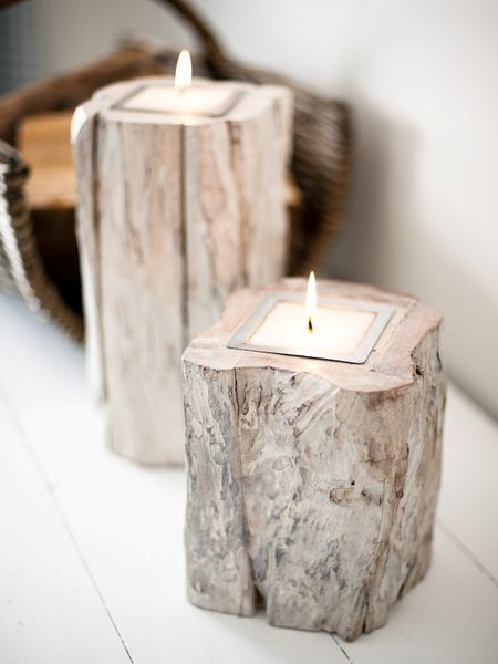 Rough Wood Block Candles. We could probably make round holes and pour the wax straight in to the wood...