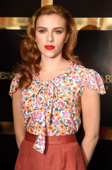 Scarlet Johansson---hair side-parted and elegantly curled.