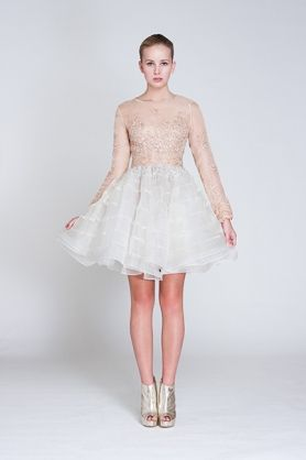 Silk Organza lace and bead embellished dress. The Jellyfish dress is a made with mesh and silk organza. This beautiful dress is delicately embellished with floral applique bead. It features a deatiled rouded neckline, long sleeves and a voluminous circle skirt. This is a beautiful and fun look.  #bridal #evening #tieredorganza #handembellished #puffskirt #lightpink #white #fun #cute #dress #specailoccasion #NARCES