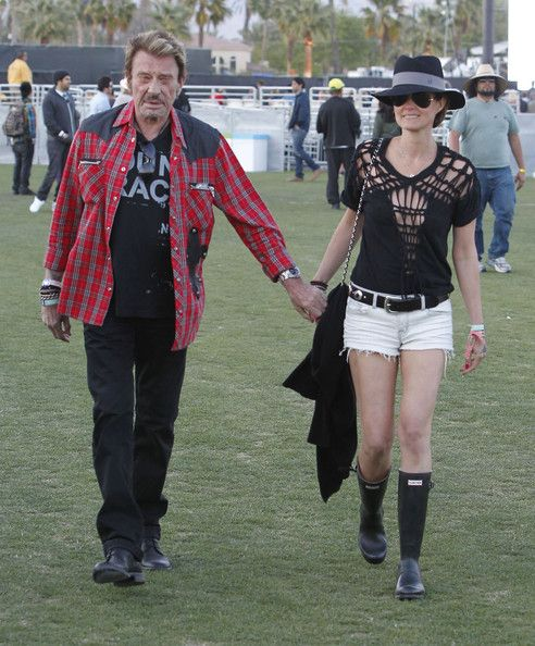 "Laeticia Hallyday Photos - Celebrities gallivant around the grass areas of the ""Coachella Music Festival? on day 2 of the massive event located in the Coachella dessert of California on April 14, 2012.<br /> <br /> Pictured: Johnny Hallyday, Laeticia Hallyday - Laeticia Hallyday Photos - 766 of 2165"