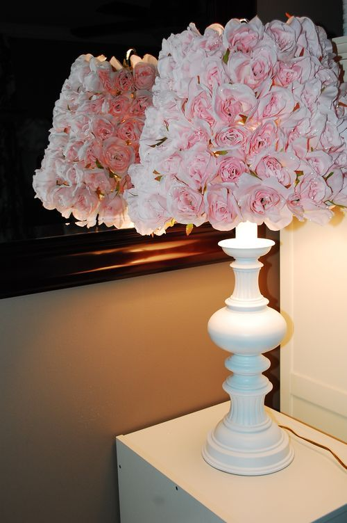 Take a cheap lamp shade. Buy roses and cut off stems and hot glue to shade.