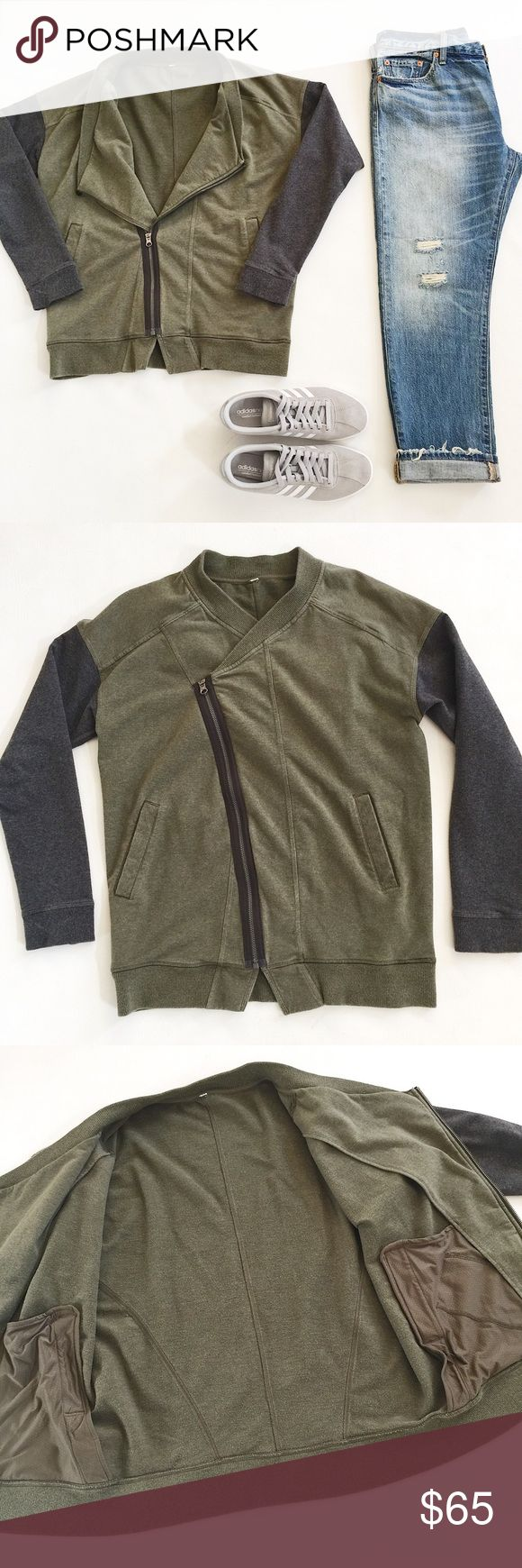 """Lululemon Mula Jacket Lululemon Mula Jacket in olive and gray featuring asymmetrical zip and draped front.  Lightweight but cozy!  Great for any workout or a lazy day!  Pre-loved but in great condition.  No holes, stains or tears.  Signs of normal wash and wear.  Size tag cut out, fits like a Large.  Please verify measurements.  Last pic stock photo, used to show fit.  Measurements laying flat: Armpit to armpit: 21"""" Waist (across): 20"""" Total length: 25.5"""" Sleeve length: 24"""" lululemon…"""